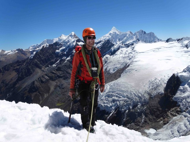 Dave on the summit of Mapiraju. Montains in the background are Chinchey (right) and Pucaranra (left).  The glacier and ice fall we could see from our camp are also in view.