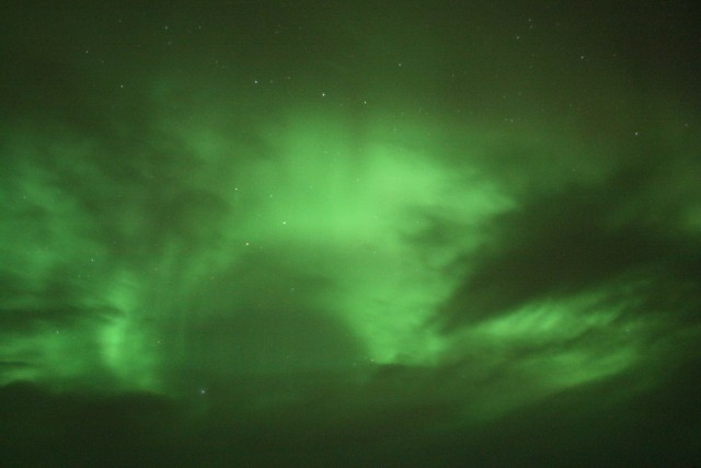 Green skies at night... aurora chasers' delight.