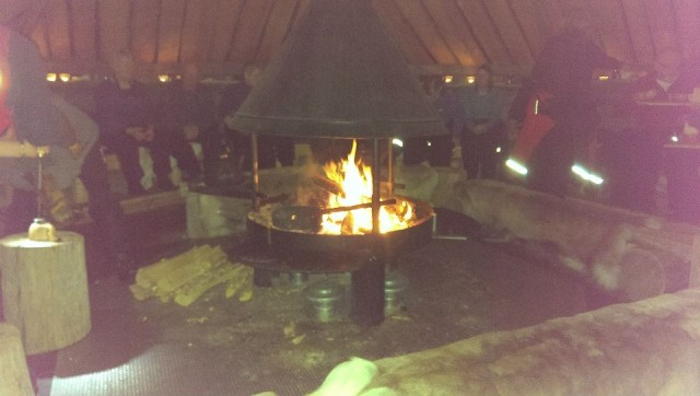 Sitting around the fire drinking (cheesy!) coffee in Lapland.