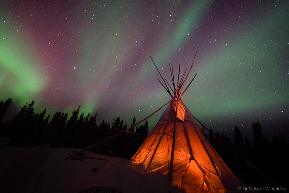 Aurora by the tipi at Blachford Lake Lodge.