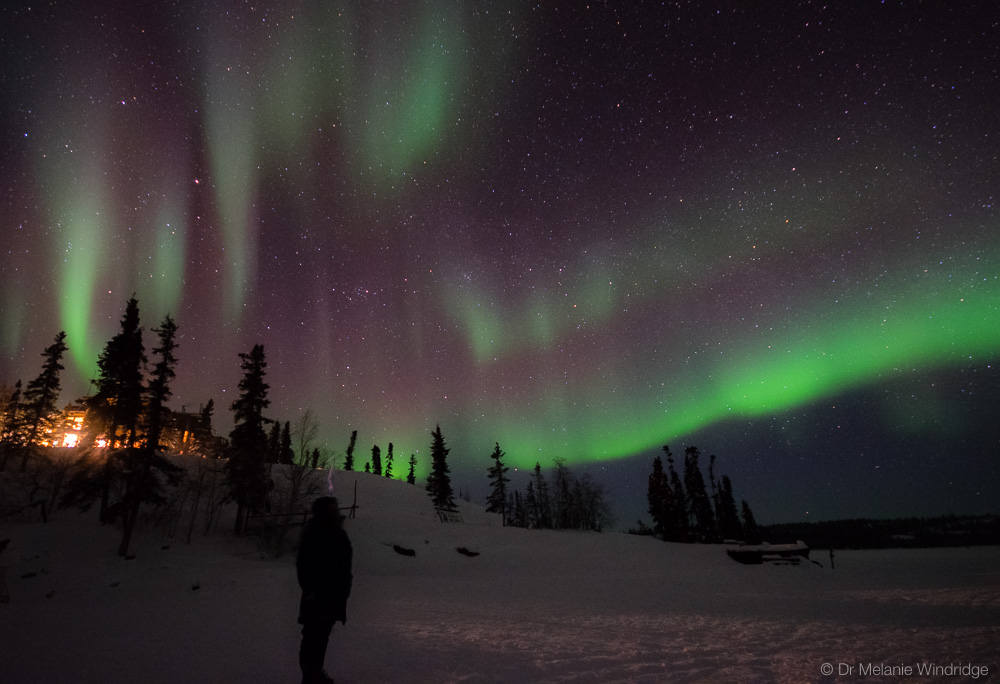 Brigitte Bustos watching the aurora at Blachford Lake Lodge.