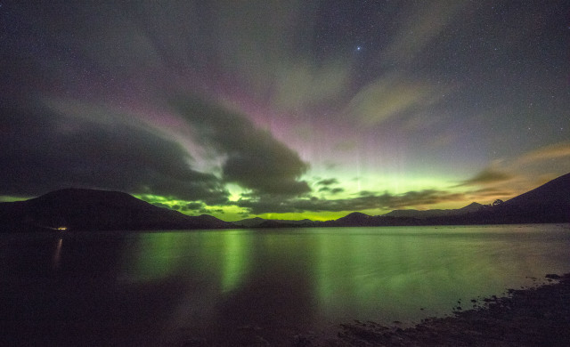 Aurora over Papanui Inlet, New Zealand, with the clouds coming in.