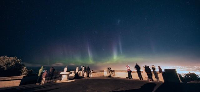 Students watching the aurora at Signal Hill, Dunedin, New Zealand.