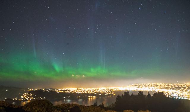 The southern lights dancing above Dunedin, New Zealand.