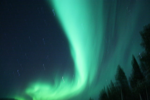 Ribbons of green aurora in Sweden.