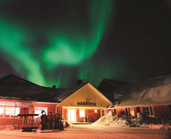 Aurora over Harriniva Wilderness Hotel, Finland. Credit: Antti Pietikainen