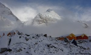 Clouds at Everest Base Camp clear to show the peak of Nuptse. Dr. Melanie Windridge