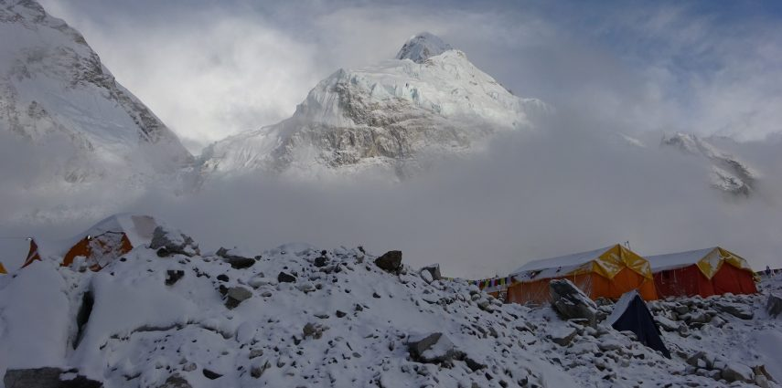 Clouds at Everest Base Camp clear to show the peak of Nuptse.