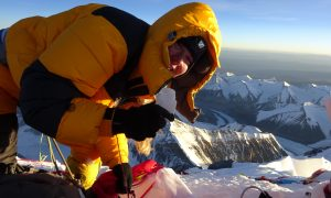 Melanie takes a snow sample on the summit of Everest