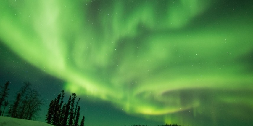 A night of active aurora at  Blachford Lake Lodge, near Yellowknife, Canada.