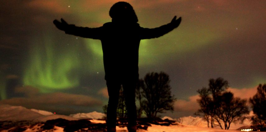 David used a timer and long exposure to capture this photo of himself experiencing the northern lights in Tromsø