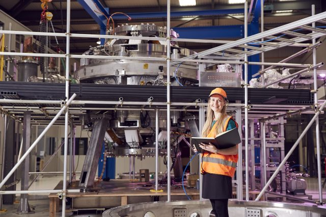 Me standing in front of the ST40 tokamak at the Tokamak Energy lab