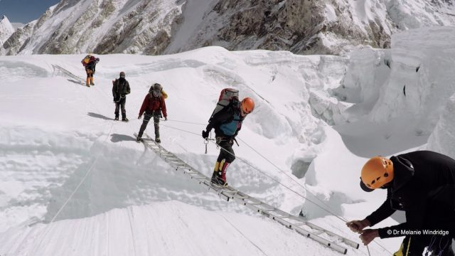 crossing a ladder over a crevasse on Everest