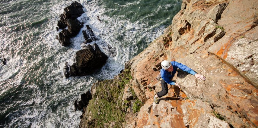 Tom climbing Book of Ages E5 6b at Gogarth. Photo: Dan Lane